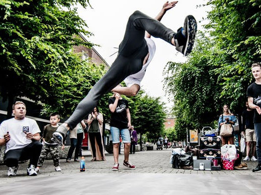 Street dancer doing a flip